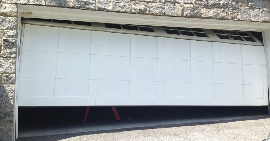 Broken garage door repairs Monroe County